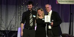 Michael Harding and Heidi Giesbrecht receive Keep Calm and Carry On award from Scott Phillips
